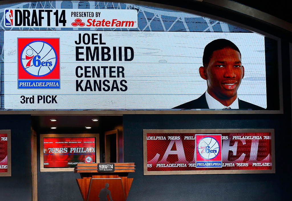 . A video screen shows the selection of Joel Embiid of Kansas as the #3 overall pick in the first round by the Philadelphia 76ers during the 2014 NBA Draft at Barclays Center on June 26, 2014 in the Brooklyn borough of New York City.   (Photo by Mike Stobe/Getty Images)