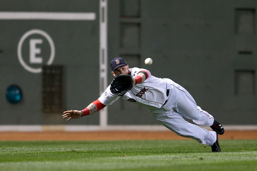 . Jonny Gomes #5 of the Boston Red Sox catches a ball hit by Matt Adams #53 of the St. Louis Cardinals in the fifth inning of Game One of the 2013 World Series at Fenway Park on October 23, 2013 in Boston, Massachusetts.  (Photo by Rob Carr/Getty Images)