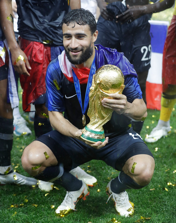 . France\'s Nabil Fekir poses with the trophy at the end of the final match between France and Croatia at the 2018 soccer World Cup in the Luzhniki Stadium in Moscow, Russia, Sunday, July 15, 2018. (AP Photo/Matthias Schrader)