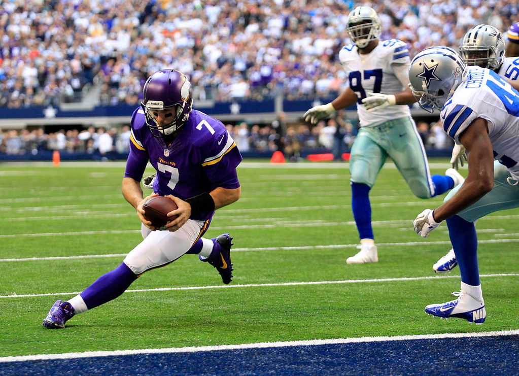 . Minnesota Vikings quarterback Christian Ponder (7) prepares to dive into the end zone for a touchdown as Dallas Cowboys\' Barry Church, right, and Jason Hatcher (97) watch in the first half of an NFL football game, Sunday, Nov. 3, 2013, in Arlington, Texas. (AP Photo/Tim Sharp)
