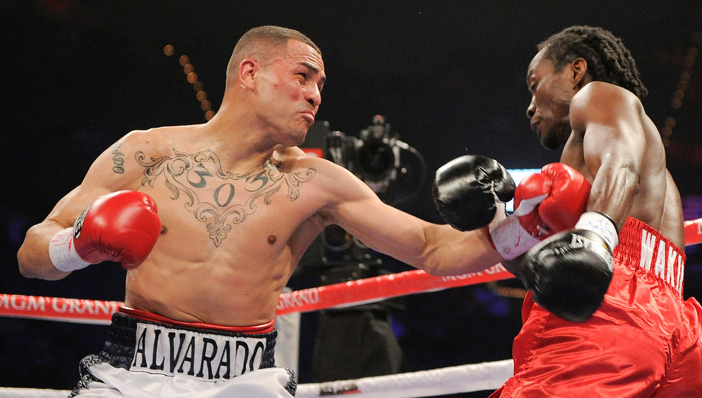 . 9. Mike Alvarado vs. Ray Narh. A large left-hand jab to the stomach of Narh in March of 2011 led to Narh refusing to come out of his corner for the fourth round and Alvardo claiming the WBC Continental Americas light welterweight title via TKO. (AP Photo/Mark Terrill)