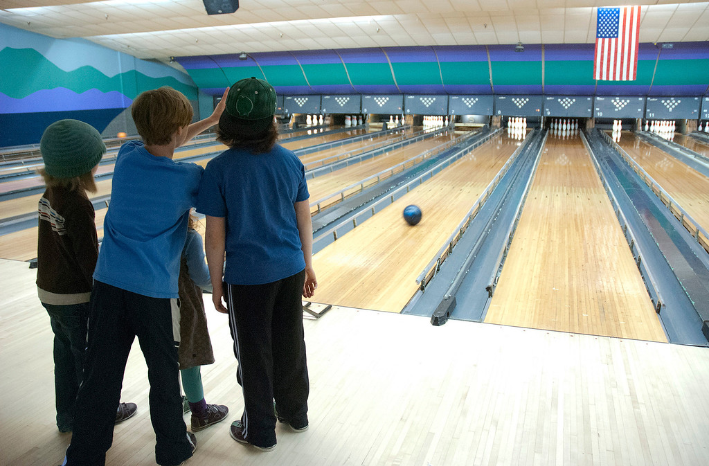 . Kayla Rice/Reformer Children work together while bowling at Brattleboro Bowl on Tuesday afternoon.