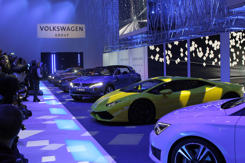 Description of . The new Lamborghini Huracan, in yellow, during a preview show of Volkswagen Group, as part of the 84th Geneva International Motor Show, Switzerland, Monday, March 3, 2014. The Motor Show will open its gates to the public from March 6 to 16. (AP Photo/Laurent Cipriani)