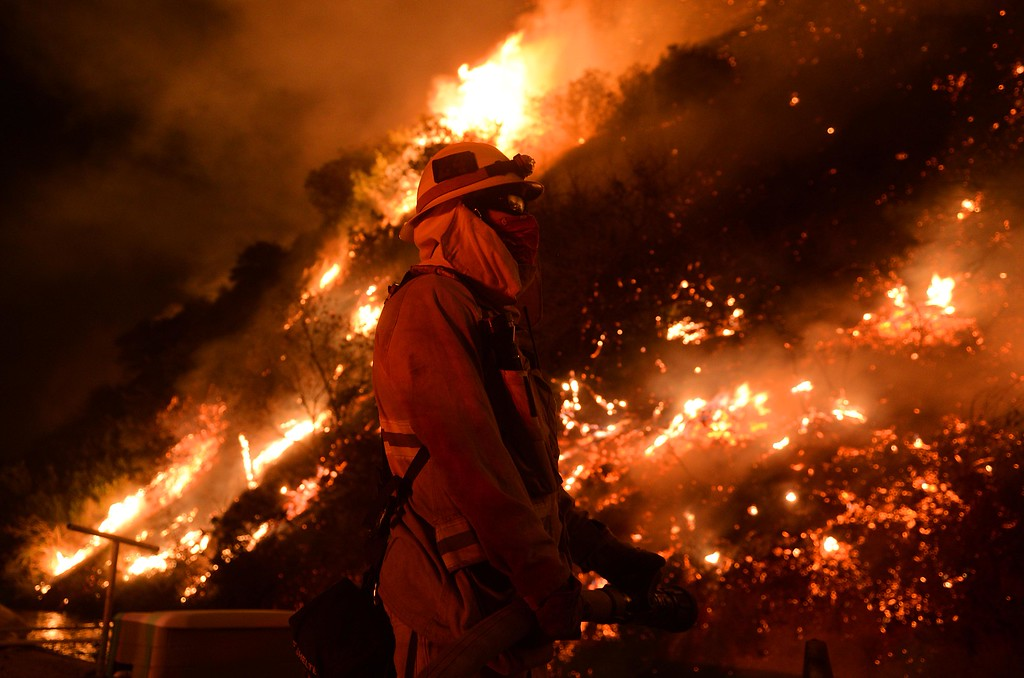 . Firefighters battle night flames next to the Canyon Filtration Plant Azusa Valley Water Co. Thursday night January16,2014 during the Colby Fire in Azusa. Fire burned 1,700 acres and started at Colby trail in the Angeles National Forest.LaFonzo Carter/ Staff Photographer