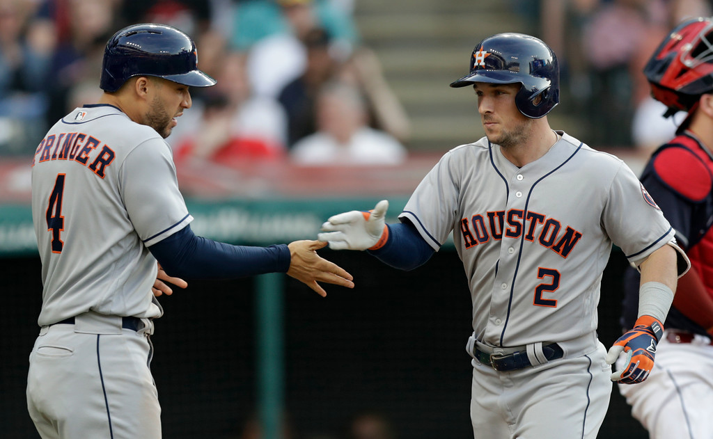 . Houston Astros\' Alex Bregman (2) and George Springer (4) celebrate after Bregman hit a three-run home run in the fifth inning of a baseball game against the Cleveland Indians, Thursday, May 24, 2018, in Cleveland. (AP Photo/Tony Dejak)