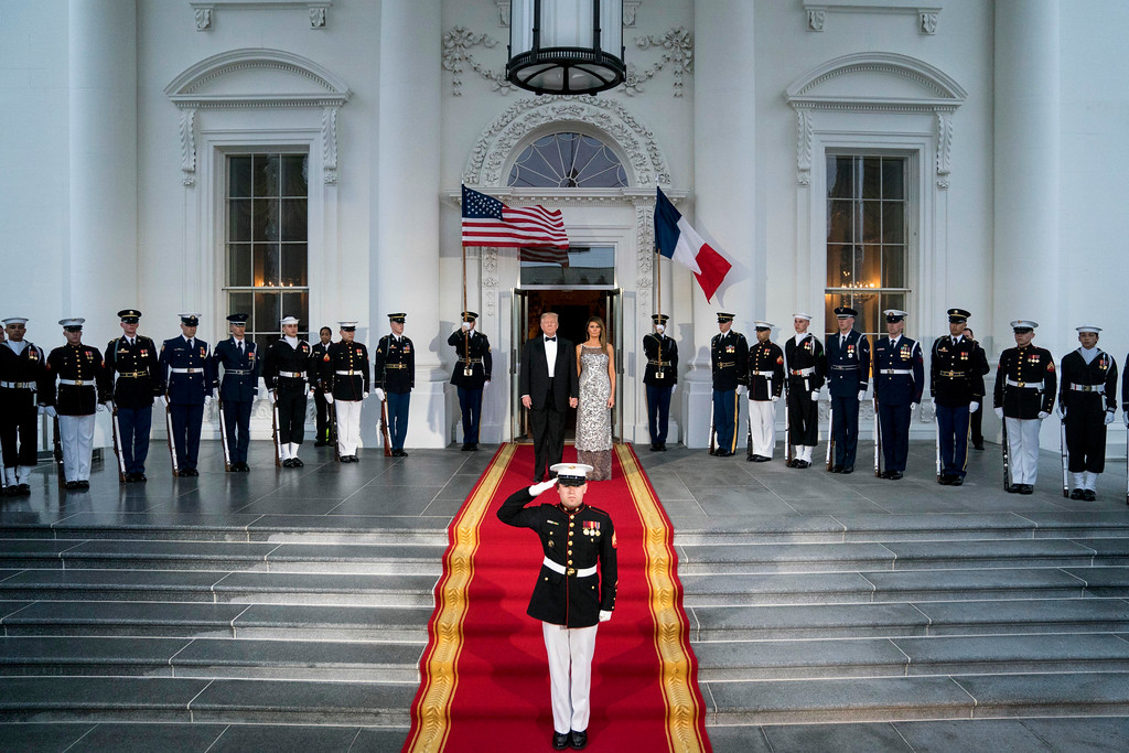 . President Donald Trump and first lady Melania Trump prepare to greet French President Emmanuel Macron and his wife Brigitte Macron as they arrive for a State Dinner at the White House in Washington, Tuesday, April 24, 2018. (AP Photo/Andrew Harnik)