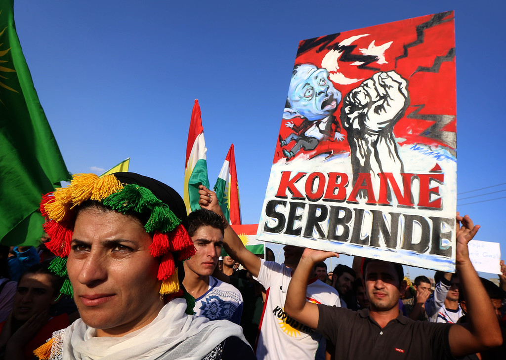 . Iraqi Kurdish supporters of the Kurdistan Workers Party (PKK) demonstrate against the threat imposed by the Islamic State (IS) group jihadists against the Syrian Kurdish town of Syrian town of Kobane, known in Arabic as Ain al-Arab, outside the UN office in Arbil, the capital of the autonomous Kurdish region on October 8, 2014. Intensified air strikes helped Kurdish militia push back Islamic State jihadists fighting for Kobane as pressure mounted for more international action to save the key Syrian border town. SAFIN HAMED/AFP/Getty Images