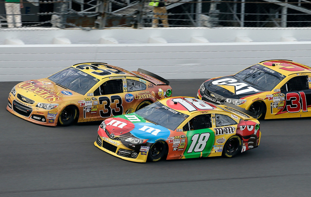 . Kyle Busch (18) races with Austin Dillon (33) and Jeff Burton (31) during the second of two 150-mile qualifying race for Sunday\'s NASCAR Daytona 500 auto race, Thursday, Feb. 21, 2013, at Daytona International Speedway in Daytona Beach, Fla. Busch won the race. (AP Photo/Chris O\'Meara)