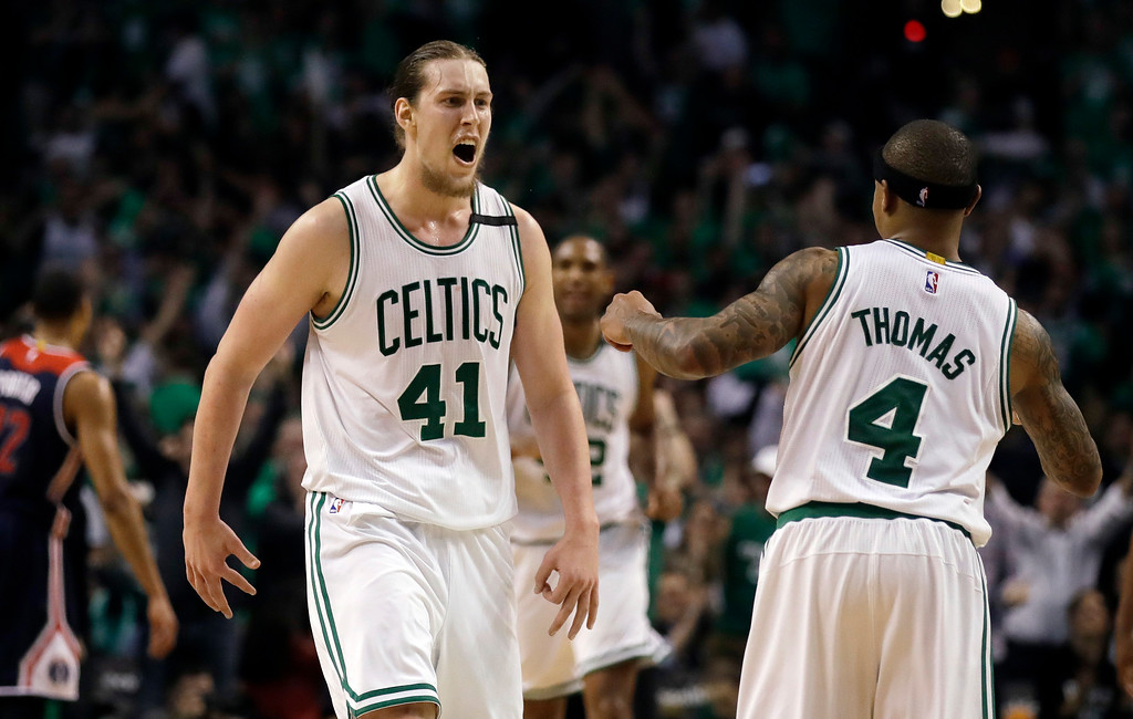 . Boston Celtics center Kelly Olynyk (41) celebrates his basket with guard Isaiah Thomas (4) during the fourth quarter of Game 7 of a second-round NBA basketball playoff series against the Washington Wizards, Monday, May 15, 2017, in Boston. (AP Photo/Charles Krupa)