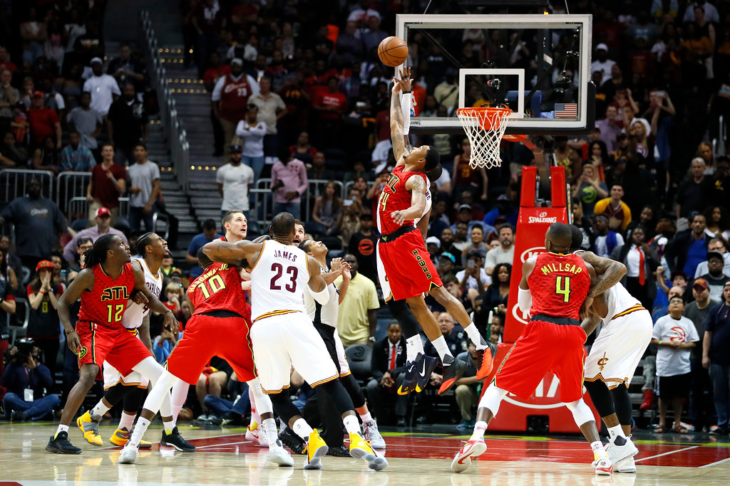 . Atlanta Hawks forward Kent Bazemore (24) goes up for the jump ball in the final seconds of the second half of an NBA basketball game against the Cleveland Cavaliers on Sunday, April 9, 2017, in Atlanta. The Hawks won in overtime 126-125. (AP Photo/Todd Kirkland)