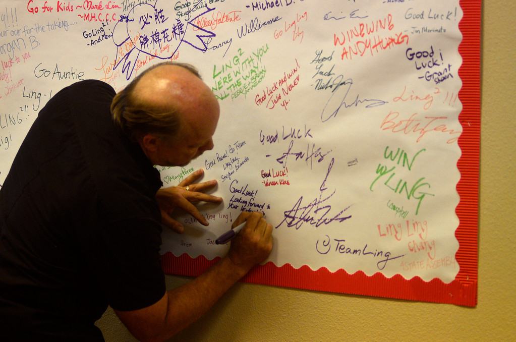 . A Ling-Ling Chang supporter signs the support sign hanging at Chang\'s campaign headquarters in Brea, Tuesday, June 3, 2014. (Photo by Robert Huskey)