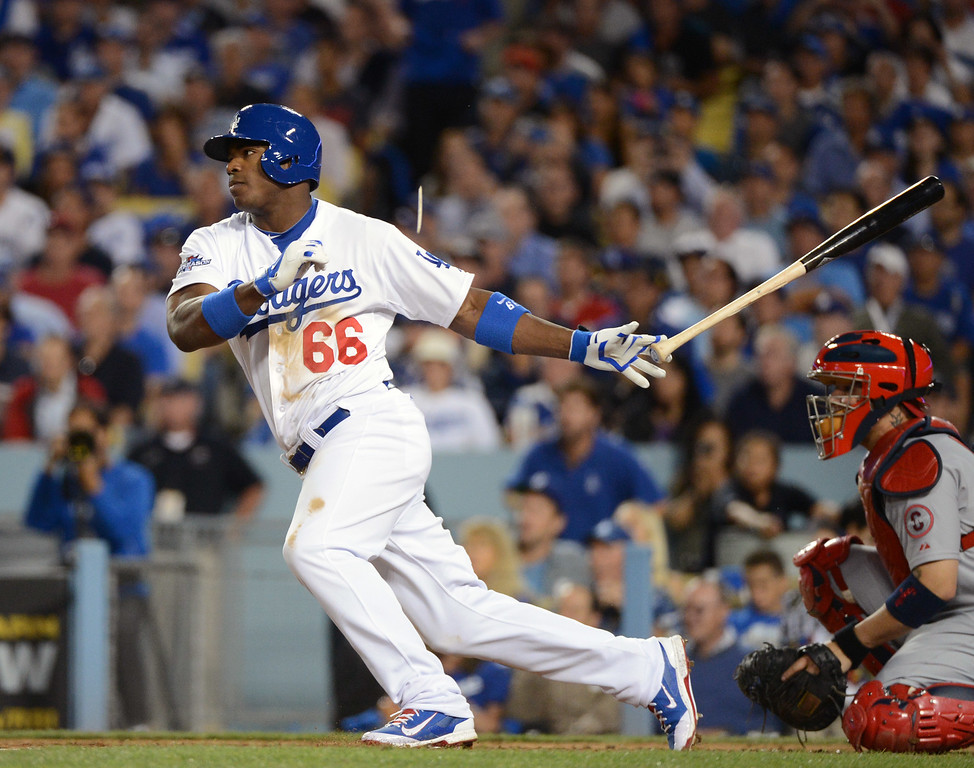 . The Dodgers\' Yasiel Puig singles to center in the 6th against the Cardinals during game 4 of the NLCS at Dodger Stadium Tuesday, October 15, 2013. (Photo by David Crane/Los Angeles Daily News)