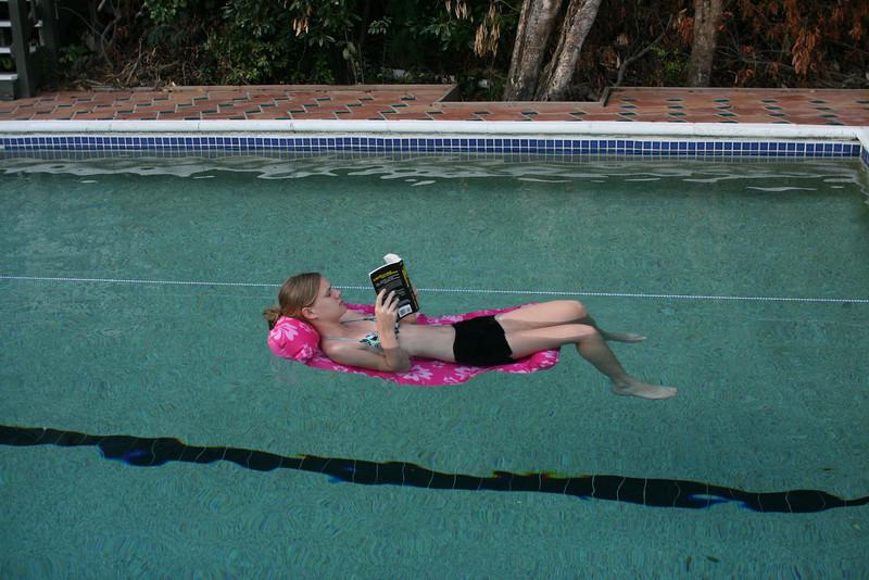 Aunika reading in the pool.