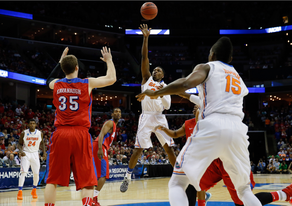 . Michael Frazier II #20 of the Florida Gators goes up for a shot against the Dayton Flyers during the south regional final of the 2014 NCAA Men\'s Basketball Tournament at the FedExForum on March 29, 2014 in Memphis, Tennessee.  (Photo by Kevin C. Cox/Getty Images)