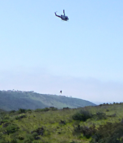 Mtn biker below helicopter