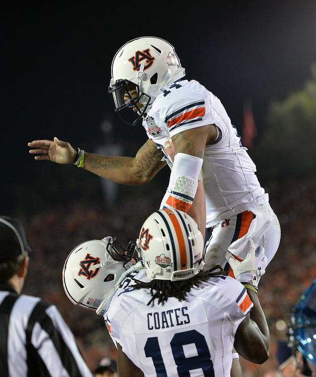. Auburn QB Nick Marshall is lifted by teammates after his second-quarter touchdown against Florida State at the BCS national championship game at the Rose Bowl, Monday, January 6, 2014. (Photo by Michael Owen Baker/L.A. Daily News)