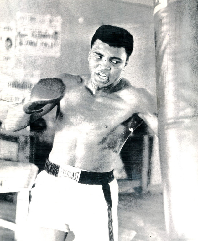 . Cassius Clay punches the heavy bag in one of his daily workouts at Miami Beach for the Feb. 25 championship bout with heavyweight Sonny Liston.  1964. Credit: AP