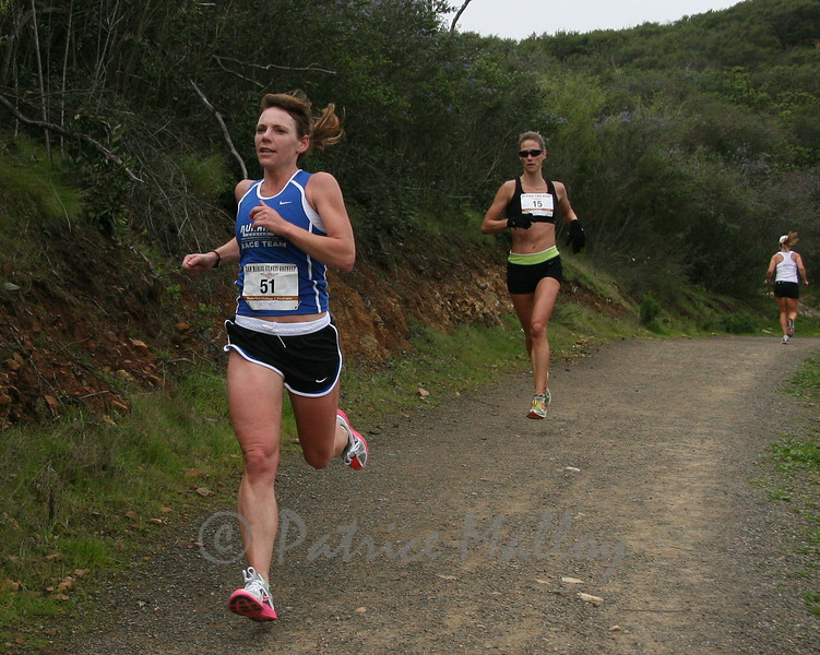 Cindy Crawford, (right) #15, of San Marcos, eventually passed Melissa Kloz  of Oceanside finishing in 49:21 for second women overall and first master woman.
