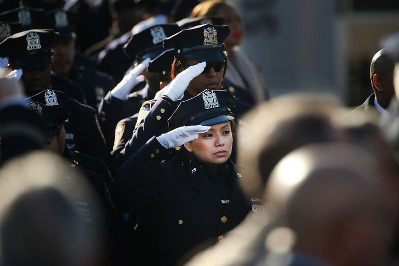 . Police officers from around the country salute outside of Christ Tabernacle Church for the funeral of slain New York City Police Officer Rafael Ramos, one of two officers murdered while sitting in their patrol car in an ambush in Brooklyn last Saturday afternoon on December 27, 2014 in New York City. Thousands of fellow officers, family, friends and Vice President Joseph Biden are expected at the church in the Glendale neighborhood of Queens for the funeral.  (Photo by Spencer Platt/Getty Images)