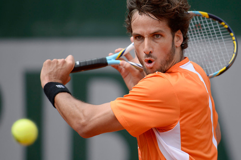 . Spain\'s Feliciano Lopez hits a shot to Portugal\'s Joao Sousa during their French Tennis Open match at the Roland Garros stadium in Paris, on May 29,  2013.  MARTIN BUREAU/AFP/Getty Images
