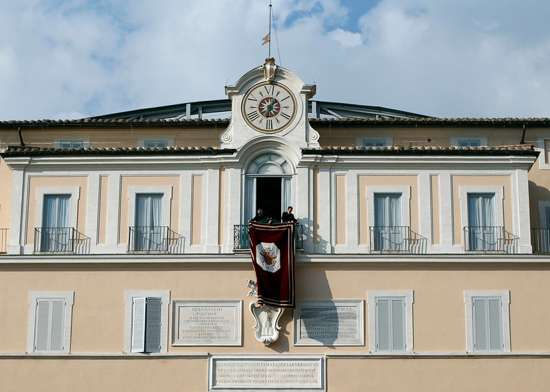 . Two men set up a tapestry at the balcony of the summer residence of Pope Benedict XVI in Castelgandolfo February 28, 2013. Pope Benedict, with only hours left in his papacy, on Thursday pledged unconditional obedience to whoever succeeds him to guide the Roman Catholic Church at one of the most crisis-ridden periods in its 2,000-year history. REUTERS/Tony Gentile
