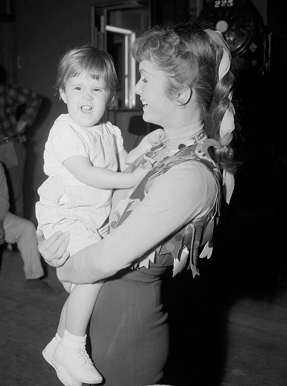. Debbie Reynolds shown holding her daughter, Carrie, 2, as the child visited the actress? studio, Feb. 21, 1959, says she wishes Eddie Fisher and Elizabeth Taylor ?every happiness together.? She divorced Fisher on Thursday, testifying that her husband had found another woman. The 26-year-old star says she is happy concentrating on her children and her film work. (AP Photo)
