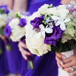 White hydrangea, orchids, purple lisianthus-  $125