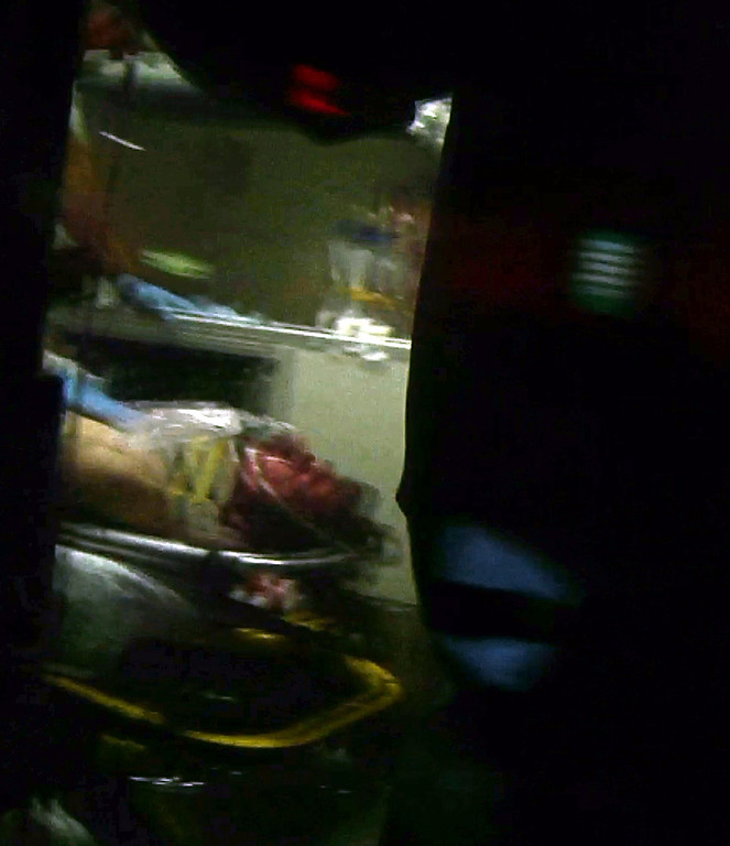 . This still frame from video shows Boston Marathon bombing suspect Dzhokhar Tsarnaev visible through an ambulance after he was captured in Watertown, Mass., Friday, April 19, 2013. A 19-year-old college student wanted in the Boston Marathon bombings was taken into custody Friday evening after a manhunt that left the city virtually paralyzed and his older brother and accomplice dead.  (AP Photo/Robert Ray)