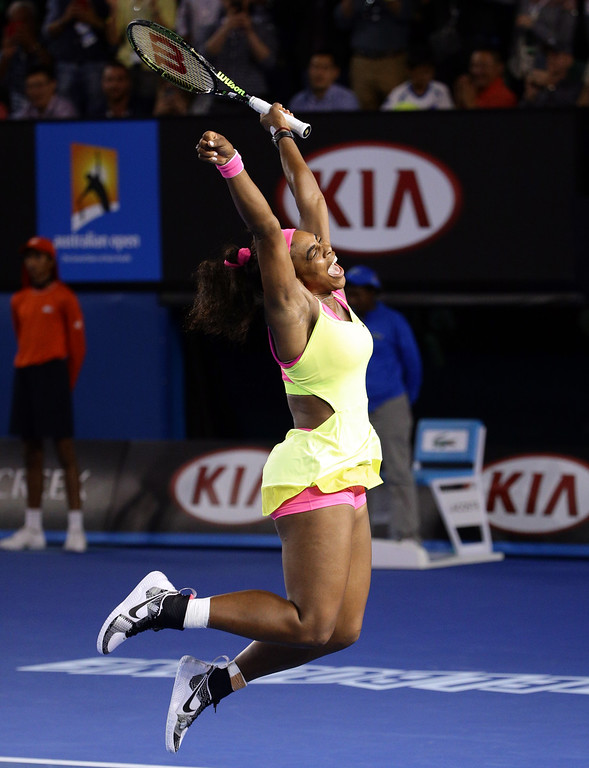 . Serena Williams of the U.S. celebrates after defeating Maria Sharapova of Russia in the women\'s singles final at the Australian Open tennis championship in Melbourne, Australia, Saturday, Jan. 31, 2015. (AP Photo/Rob Griffith)