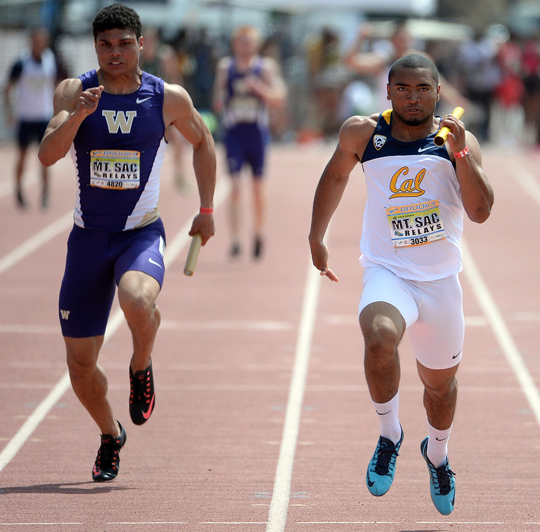. Cal\'s Khalfani Muhammad, right, competes in the 4x100 meter relay Invitational Elite during the Mt. SAC Relays in Hilmer Lodge Stadium on the campus of Mt. San Antonio College in Walnut, Calif., on Saturday, April 19, 2014. 
