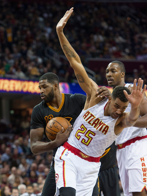 . Cleveland Cavaliers\' Tristan Thompson grabs a rebound as Atlanta Hawks\' Thabo Sefolosha (25) falls away during the first half of an NBA basketball game in Cleveland, Tuesday, Nov. 8, 2016. (AP Photo/Phil Long)