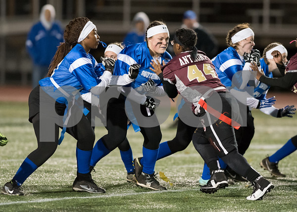 11/22/17 Wesley Bunnell | Staff Southington defeated New Britain in the annual Powder Puff game at Veterans Stadium in New Britain on Wednesday night. Southington offensive line players defend against Chelsea Anthony (44).