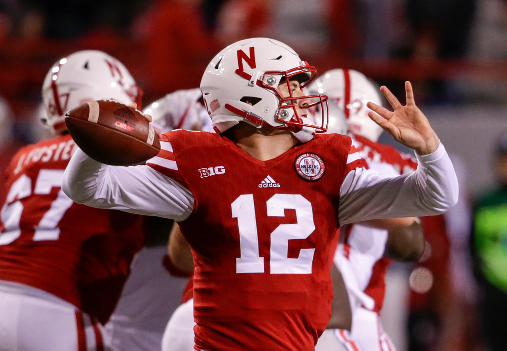 . Nebraska quarterback Patrick O\'Brien (12) throws during the second half of an NCAA college football game against Ohio State in Lincoln, Neb., Saturday, Oct. 14, 2017. Ohio State won 56-14. (AP Photo/Nati Harnik)