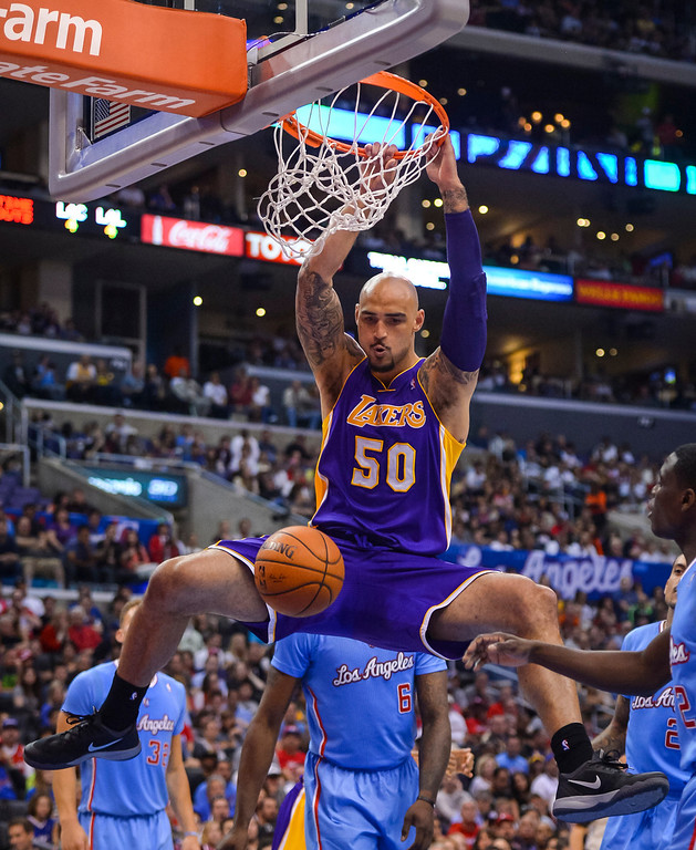 . Lakers� Robert Sacre slams in two points during game action at Staples Center Sunday April 6, 2014. Clippers defeated the Lakers 120-97.  ( Photo by David Crane/Los Angeles Daily News )