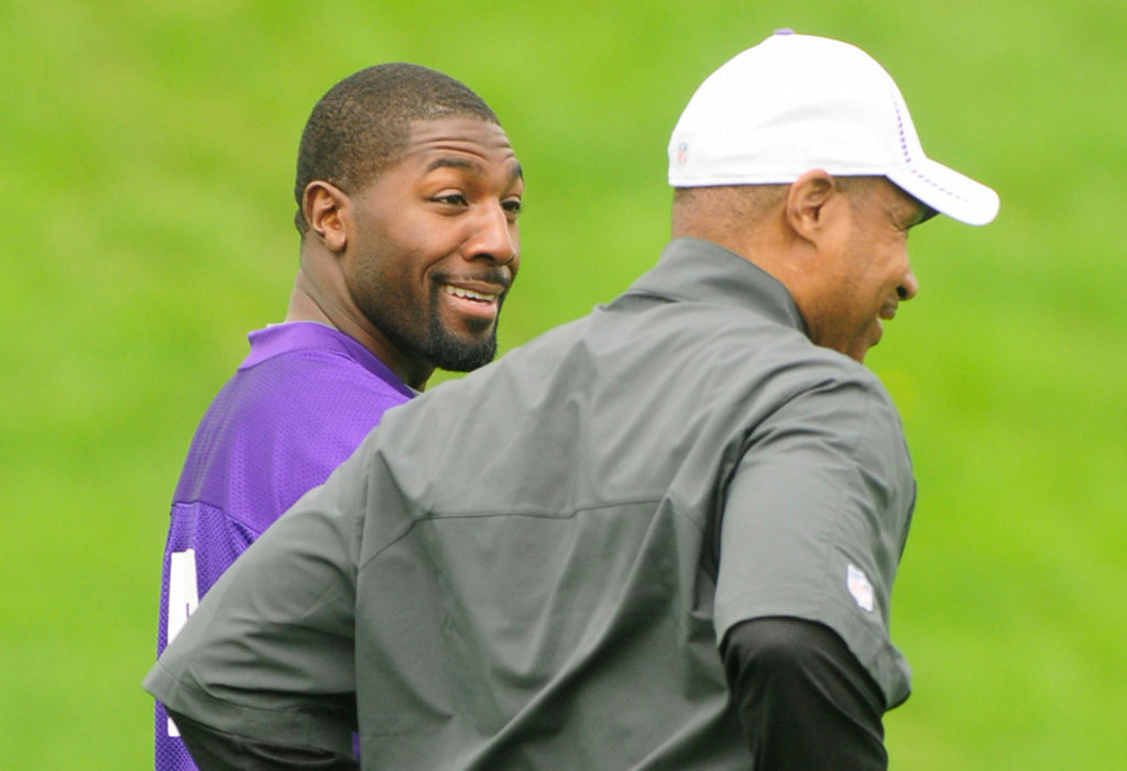 . Wide receiver Greg Jennings, left, talked with head coach Leslie Frazier, during the team\'s practice in Eden Prairie on Wednesday.  (Pioneer Press: Scott Takushi)