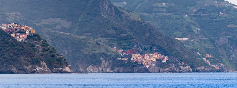colorful coastal homes on green sloped hills of the Ligurian Coast