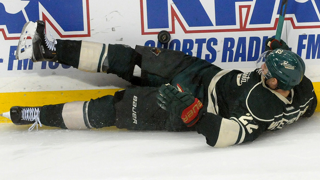 . Minnesota Wild  Nino Niederreiter slides along the boards with the puck above him during the third  period.   (Pioneer Press: Sherri LaRose-Chiglo)