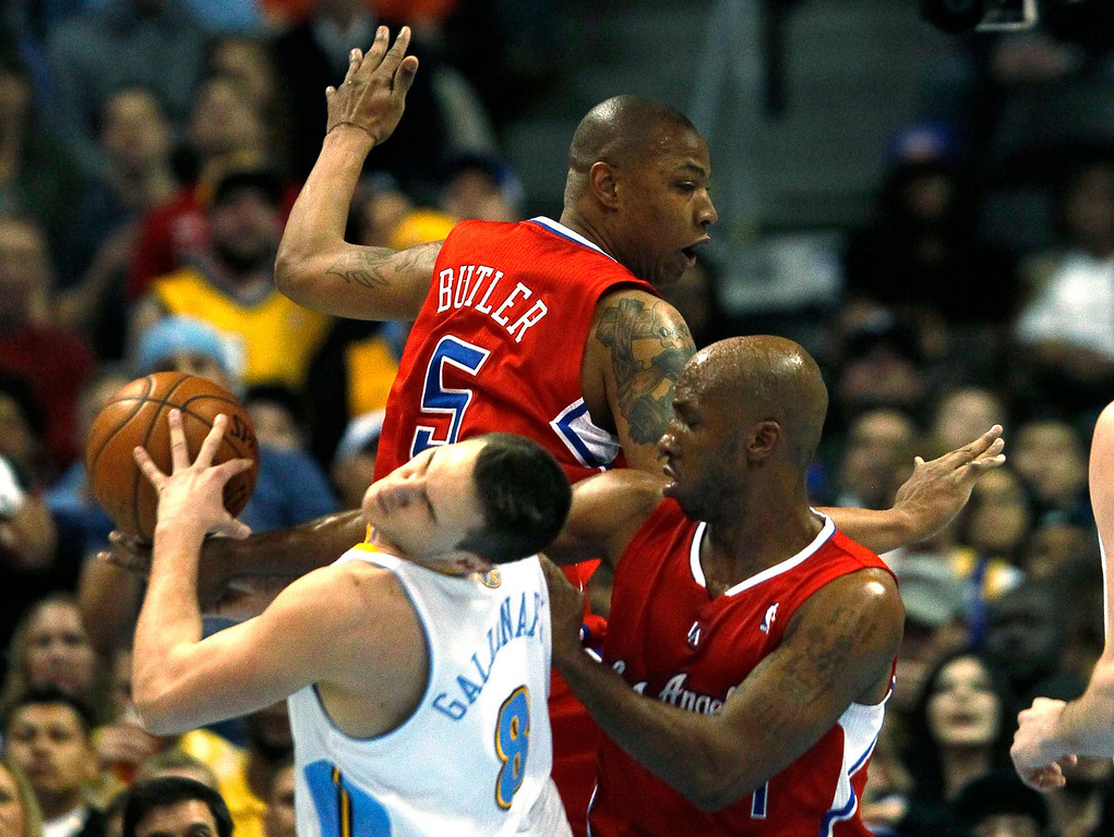 . Denver Nuggets\' Danilo Gallinari (L) is fouled by Los Angeles Clippers\' Chauncey Billups in their NBA basketball game in Denver March 7, 2013. REUTERS/Rick Wilking