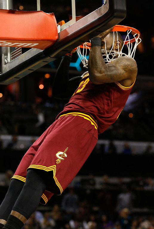 . Cleveland Cavaliers forward LeBron James does a pull-up on the rim before the start of the game as Cleveland plays the Charlotte Hornets in the first half of an NBA basketball game in Charlotte, N.C., Saturday, Dec. 31, 2016. (AP Photo/Nell Redmond)