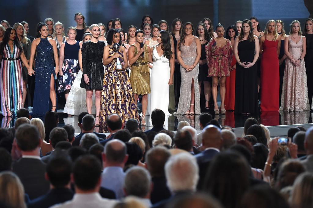 . Host Danica Patrick appears with the winners of the Arthur Ashe Award for Courage, at the ESPY Awards at the Microsoft Theater on Wednesday, July 18, 2018, in Los Angeles. More than 140 survivors of sexual abuse by a former team doctor for USA Gymnastics and Michigan State University joined hands on stage to be honored with the award. (Photo by Phil McCarten/Invision/AP)
