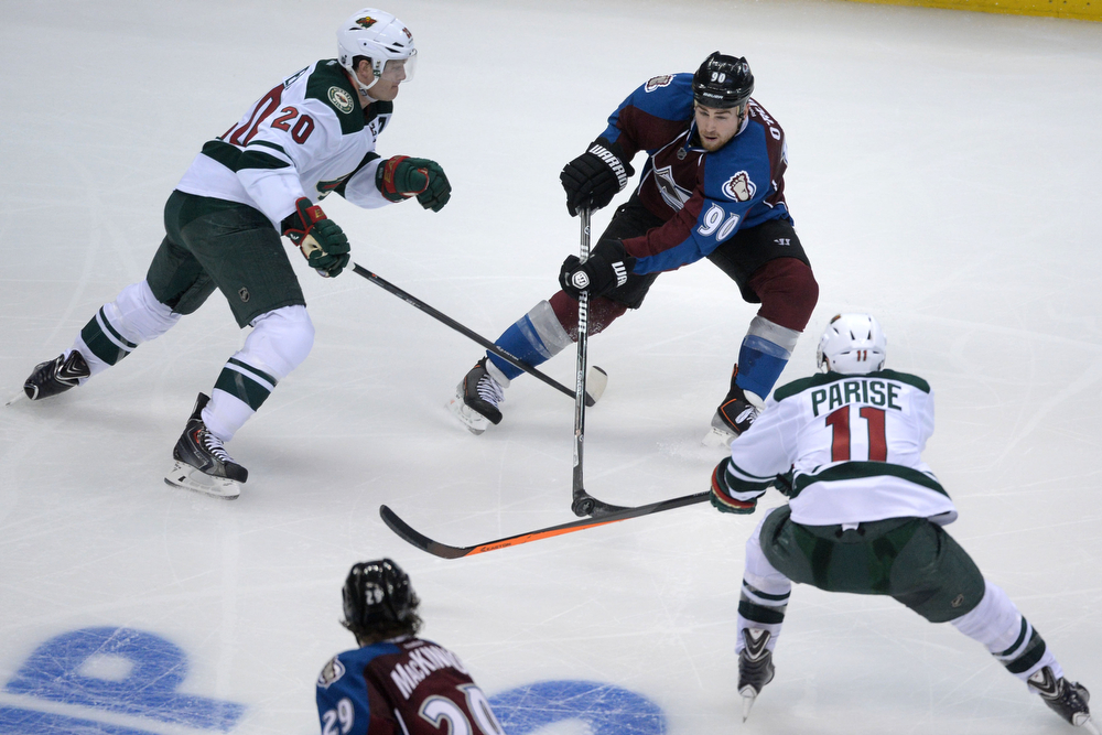 . DENVER, CO - APRIL 17: Ryan O\'Reilly (90) of the Colorado Avalanche controls the puck as Ryan Suter (20) of the Minnesota Wild and Zach Parise (11) defend during the third period of action. The Colorado Avalanche hosted the Minnesota Wild during the first round of the NHL Stanley Cup Playoffs at the Pepsi Center on Thursday, April 17, 2014. (Photo by Karl Gehring/The Denver Post)