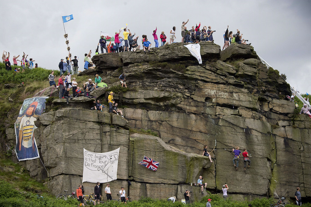 . Supporters are pictured on a rock near the road during the 201 km second stage of the 101th edition of the Tour de France cycling race on July 6, 2014 between York and Sheffield, northern England.  AFP PHOTO / JEFF PACHOUDJEFF PACHOUD/AFP/Getty Images