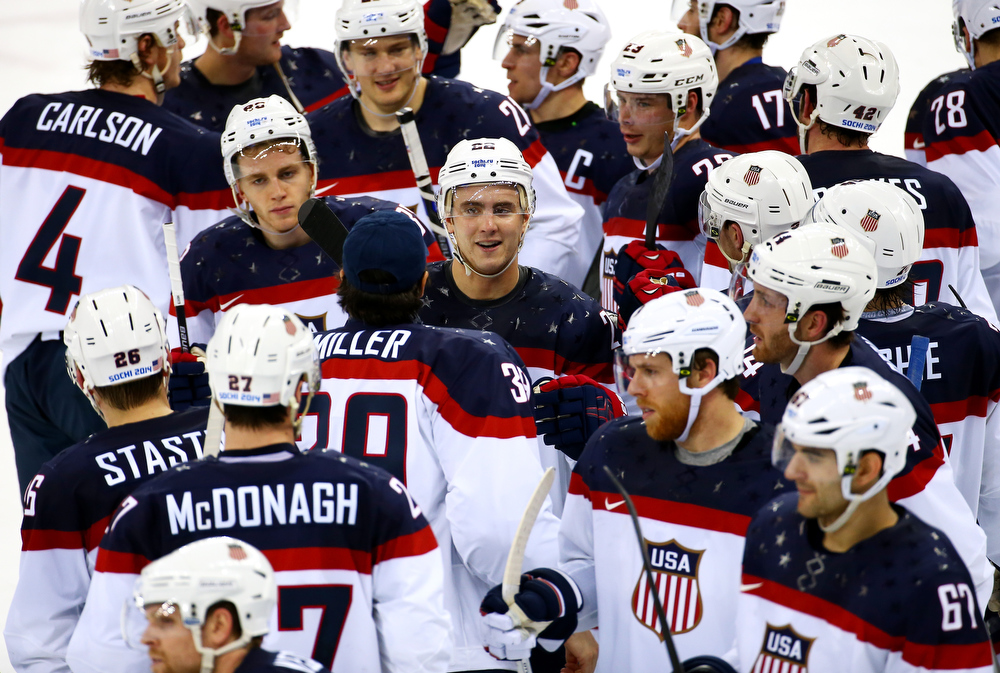 . The United States celebrate winning 7-1 against Slovakia during the Men\'s Ice Hockey Preliminary Round Group A game on day six of the Sochi 2014 Winter Olympics at Shayba Arena on February 13, 2014 in Sochi, Russia.  (Photo by Streeter Lecka/Getty Images)