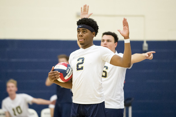 Newington boys volleyball vs Westfield MA on Monday night at Newington High School. Louis Egbuna (2) and Julian Ortiz (16) wait on an official's call. Wesley Bunnell | Staff