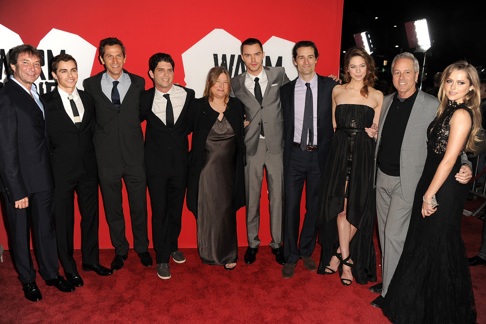"Description of . Lionsgate Motion Picture Group Co-Chairman Patrick Wachsberger, actor Dave Franco, Lionsgate Motion Picture Group President of Production Erik Feig, Director Jonathan Levine, Producer Bruna Papandrea, Actor Nicholas Hoult, Producer Todd Lieberman, Actress Analeigh Tipton, Producer David Hoberman and Actress Teresa Palmer arrive for the Los Angeles premiere of Summit Entertainment\'s ""Warm Bodies\"" at ArcLight Cinemas Cinerama Dome on January 29, 2013 in Hollywood, California.  (Photo by Kevin Winter/Getty Images)"