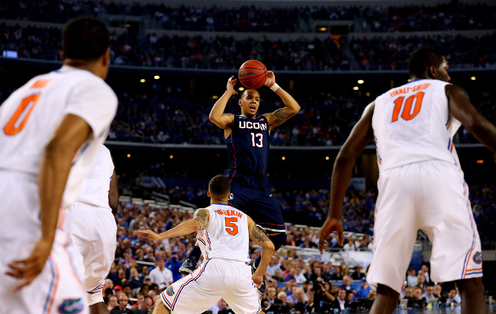 . ARLINGTON, TX - APRIL 05: Shabazz Napier #13 of the Connecticut Huskies loses control of the ball as Scottie Wilbekin #5 of the Florida Gators defends during the NCAA Men\'s Final Four Semifinal at AT&T Stadium on April 5, 2014 in Arlington, Texas.  (Photo by Ronald Martinez/Getty Images)
