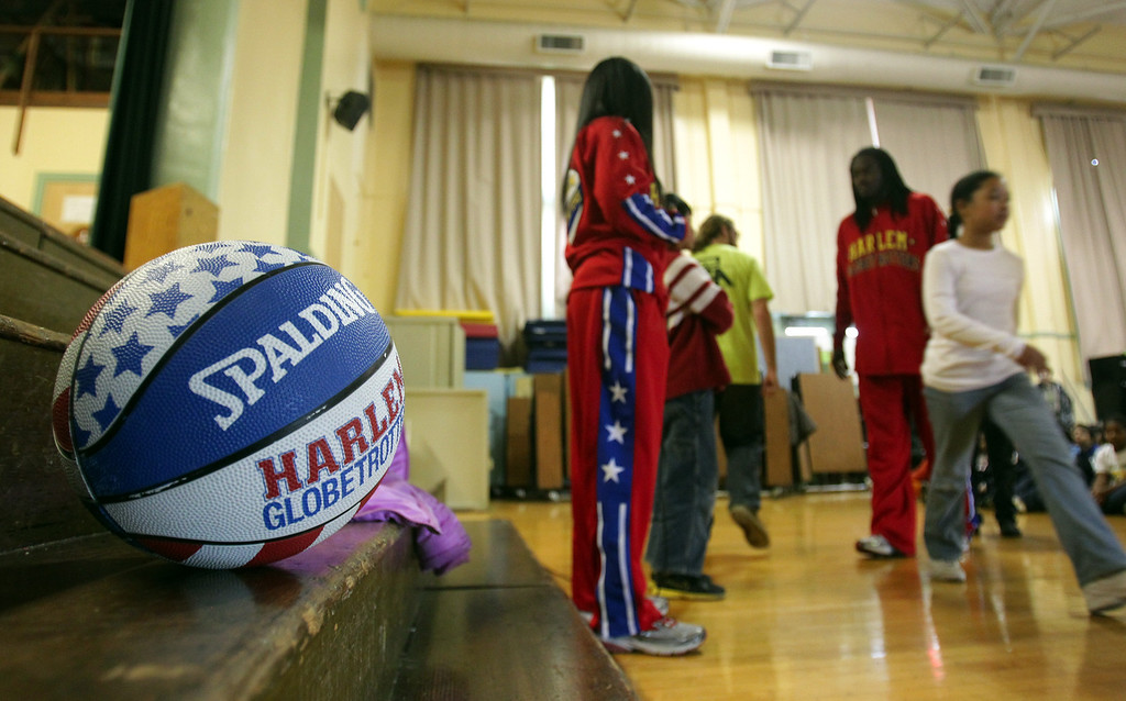 . Harlem Globetrotters� Slick Willie Shaw and rookie teammate and Oakland native Tammy �T-Time� Brawner visit Laurel Elementary School in Oakland, Calif., on Wednesday, Jan. 16, 2013. (Anda Chu/Staff)
