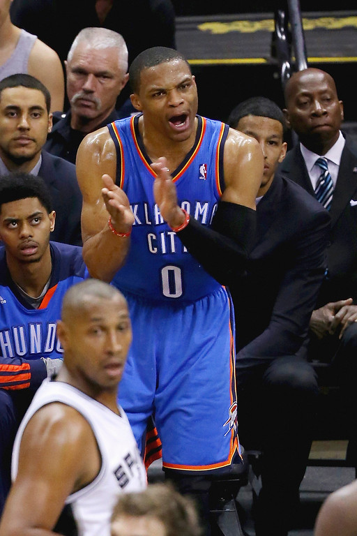. Russell Westbrook #0 of the Oklahoma City Thunder claps on the bench in the first half against the San Antonio Spurs during Game Five of the Western Conference Finals of the 2014 NBA Playoffs at AT&T Center on May 29, 2014 in San Antonio, Texas.   (Photo by Chris Covatta/Getty Images)