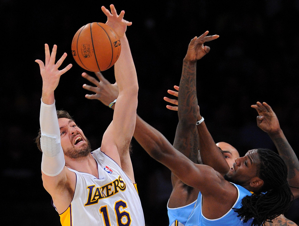 . Lakers Pao Gasol pulls down a rebound against the Nuggets at the Staple Center in Los Angeles, CA on Sunday, January 5, 2014. 1st half.  (Photo by Scott Varley, Daily Breeze)