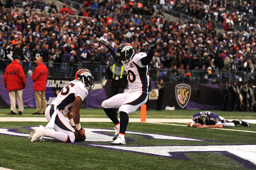 Description of . Denver Broncos cornerback Chris Harris #25 celebrates his interception for a touchdown with Baltimore Ravens quarterback Joe Flacco #5 on the ground in the background in the first half against the Baltimore Ravens at the M&T Bank Stadium, in Baltimore , MD Sunday December 16, 2012.      Joe Amon, The Denver Post